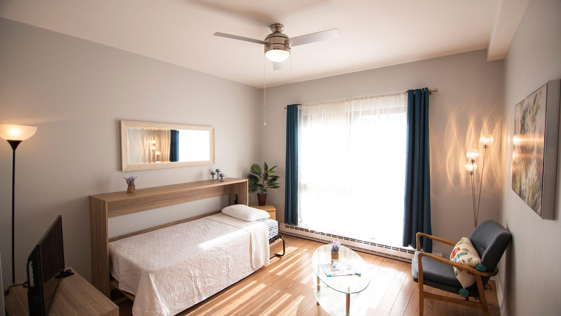 Aire de vie avec lit escamotable